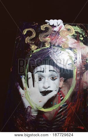 Face Of Mime Behind Glass