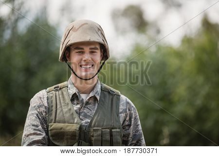 Portrait of smiling military soldier in boot camp