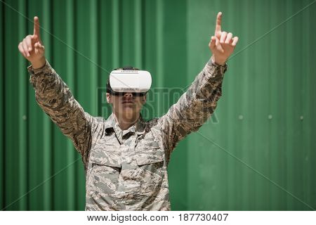 Military soldier using virtual reality headset in boot camp