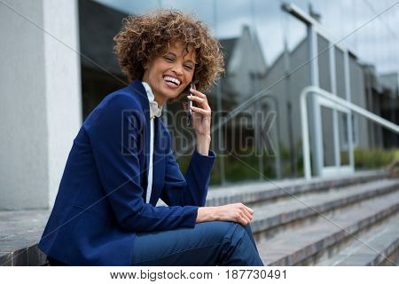 Businesswoman talking on mobile phone in the office premises
