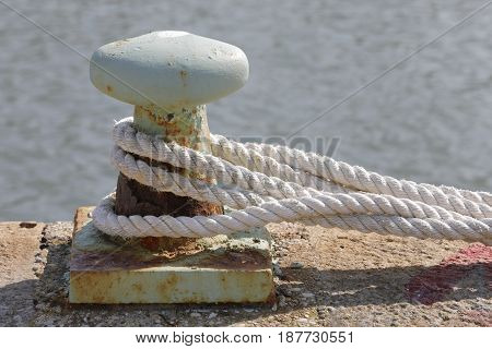 Large ropes connected to mooring at the dock
