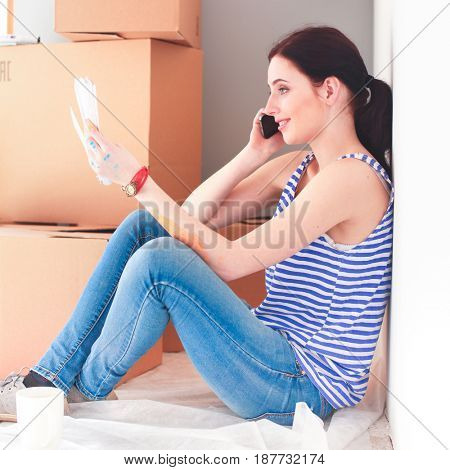 Woman in a new home with cardboard boxes