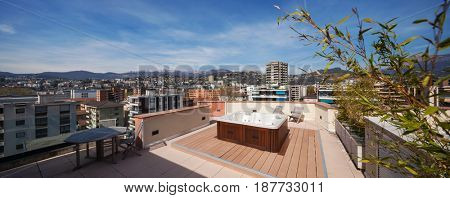 Palace terrace with tub, city view