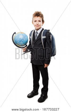 Handsome smiling child boy pupil in business suit hand holding planet Earth globe and school backpack white isolated