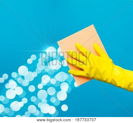 Man wiping window with rag