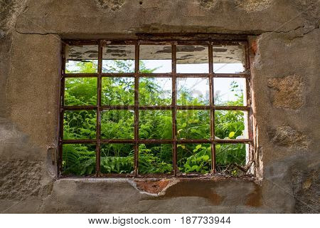Window of abandoned house building. Ancient ruins of Europe.