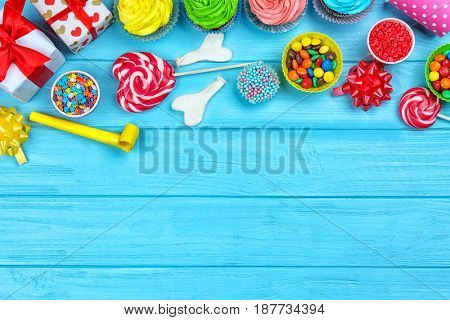 Bright birthday decor on color background