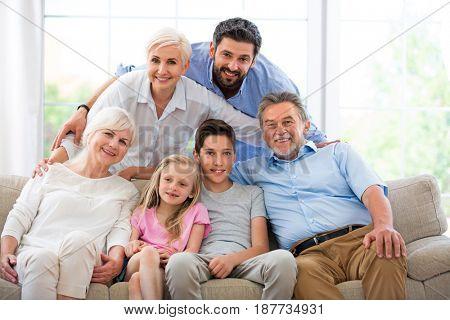 Smiling family on sofa
