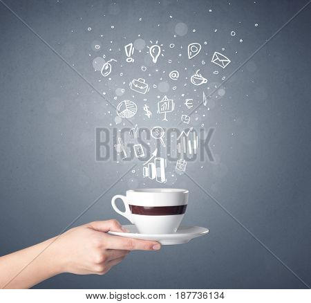 Young female hand holding coffee cup with business related drawings above it