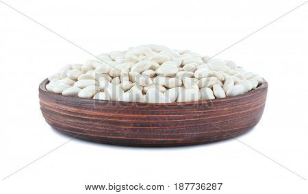 Plate with butter beans on white background