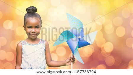 Digital composite of Portrait of cute girl holding pinwheel