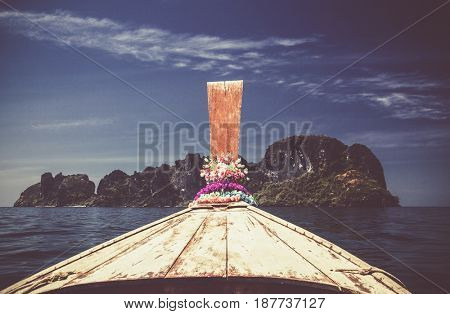 detail of long tail boat approaching islands in the Adaman sea, Thailand