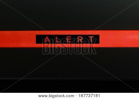 Red glowing rectangular warning lamp or button black panel with the words,