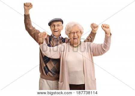 Joyful mature couple gesturing happiness isolated on white background