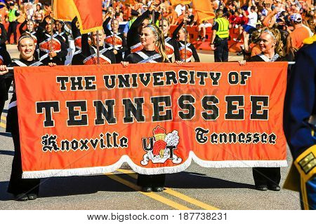 Knoxville, TN, USA - 09/17/2016: Cheerleaders from the University of Tennessee carry the banner into Neyland Stadium in KNoxville TN