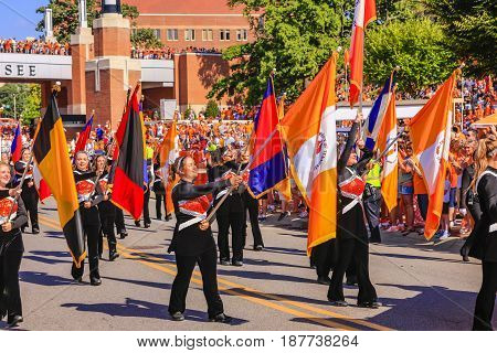 Knoxville, TN, USA - 09/17/2016: Flags of the University of Tennessee and Volunteers Football team being carried into the Neyland Stadium in Knoxville TN