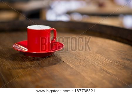 Close-up of red cup and saucer on table in cafe