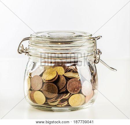 euro coin in classic glass jar
