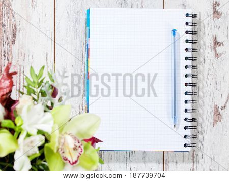 Notebook with pen for planning. Empty list