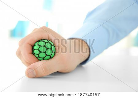 Hand of man with stress ball, closeup