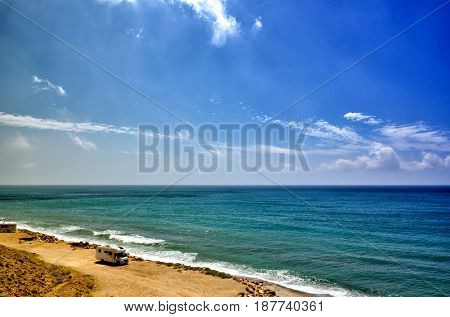 Holiday at the sea in a caravan, free camping on the beach with a motorhome