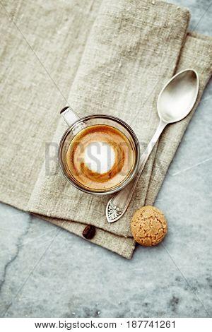 Cup of Espresso Macchiato on a linen napkin
