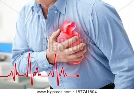 Heart attack concept. Senior man suffering from chest pain, closeup