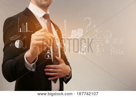 Marketing concept. Man presenting business plan on virtual screen