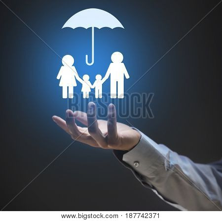 Insurance concept. Businessman holding symbol of family in hand, closeup