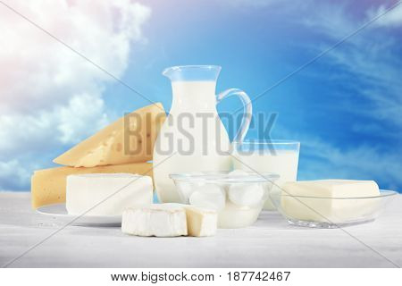 Assortment of fresh dairy products on sky background