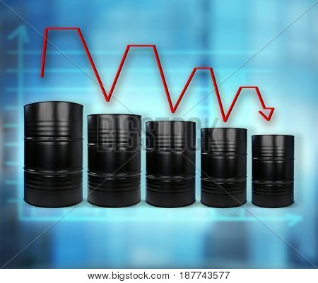 Oil prices concept. Barrels of black gold on blurred background