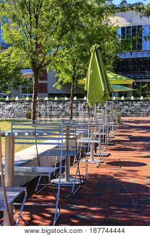 Lexington, KY, USA - 09/14/2016: Tables and chairs in Triangle Park in downtown Lexington KY