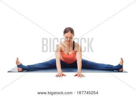 Woman doing Ashtanga Vinyasa Yoga asana Upavistha konasana - wide angle seated forward bend pose isolated on white