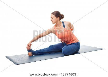 Woman doing Hatha yoga asana Ardha baddha padma paschimottanasana - half bound lotus intense west stretch isolated on white background