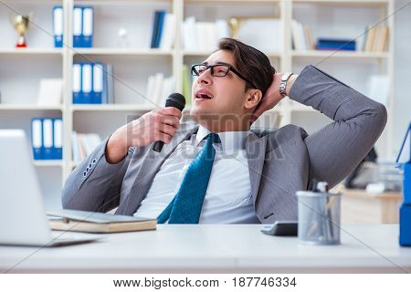Businessman singing in the office