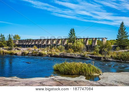 Indian summer in Manitoba, Canada. The ruins of the old dam. Lovely place to relax. Winnipeg River, Old Pinawa Dam Park. The concept of ecological and recreational tourism