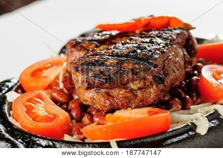 Beef steak with red beans garnish