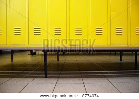 Yellow doors in a locker room and a bench