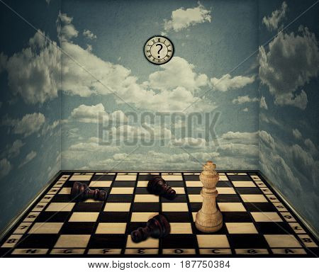 Business idea as a magical room with a chess board floor surrounded by the walls with clouds texture as limitations and the king piece winning in front of beaten pawns laying down. Victory concept.