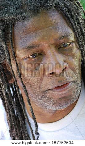 African american male with dreadlocks hair outdoors.