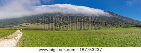 French countryside. Landscape on the plateau of Vercors with cloud formation in the mountains.