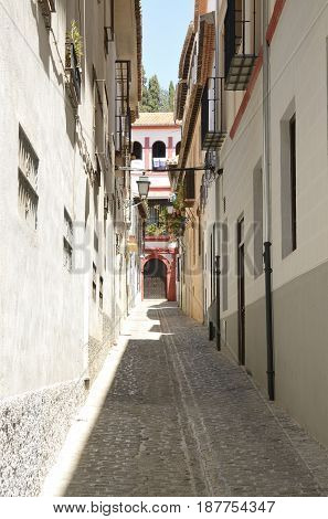 Charming narrow alley in the quarter of Albayzin in Granada Andalusia Spain.