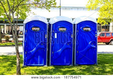 Nashville, TN, USA - 04/09/2015: Line of blue port-a-loo cabins in Nashville