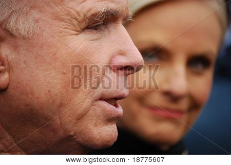 Senator John McCain, closeup with wife Cindy McCain looking at him