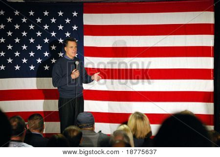 Governor Mitt Romney speaking in front of US flag
