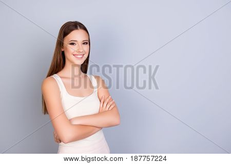 Young Gorgeous Successful Girl Is Standing On The Pure Light Blue Background And Smiling, Wearing A