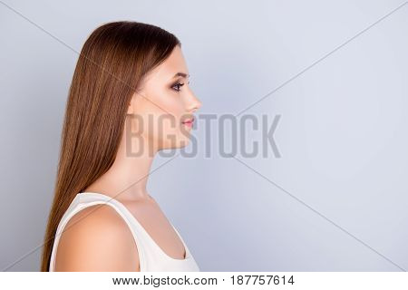 Close Up Profile Portrait Of Young Pretty Lady In White Casual Singlet On Pure Background With Copy