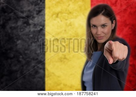 Beautiful Businesswoman Pointing Her Finger At You Belgian Flag Background.