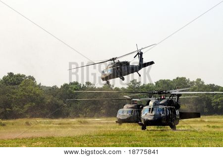 KILL DEVIL HILLS, NC - AUG 5: Three Sikorsky UH-60 Black Hawk helicopters spewing debris. Based at Fort Bragg, the helicopters visited Wright Brothers Nat. Mem. on Aug 5, 2008. Over 200 are in Iraq.