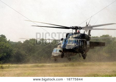 KILL DEVIL HILLS, NC - AUG 5: Two Sikorsky UH-60 Black Hawk helicopters spewing debris. Based at Fort Bragg, the helicopters visited Wright Brothers Nat. Mem. on Aug 5, 2008. Over 200 are in Iraq.